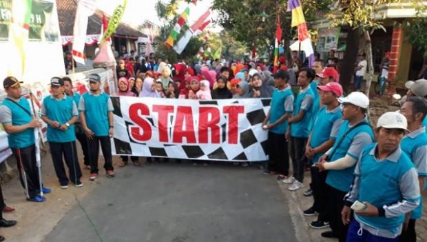 Serentak Seluruh Desa, Tua Muda Ramaikan Jalan Sehat Hari Jadi Ngawi ke 660