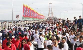 Polres Ngawi Berangkatkan Seribu Peserta Ikuti Puncak Millenial Road Safety Festival Polda Jatim