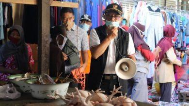 Photo of Pemkab Ngawi Sosialisasikan Wajib Masker Serentak di Beberapa Pasar